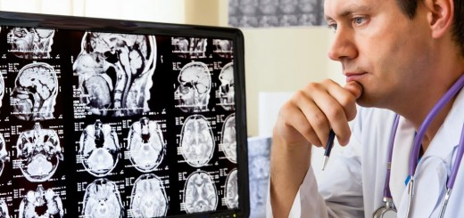 doctor-looking-at-brain-scans-on-computer