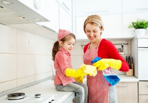 Mother and daughter cleaning in the kitchen