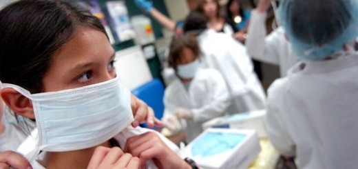 Eleven-year-old Annalisa Revilla, left, dons a surgical mask along side other campers of Science Exploration Academy Camp as they learn in the School of Nursing Simulation Center at the Texas Tech Health Science Center, Tuesday morning. The camp offers youth an opportunity to learn about all types of science in real life situations. Tuesday, June 30, 2009 (Photo by Geoffrey McAllister/Lubbock Avalanche-Journal)